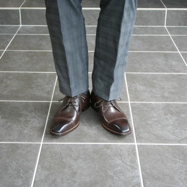 Photo men`s business shoes-Sophisticated design-dark brown mocha tone-2 shoes gray suit legs front view