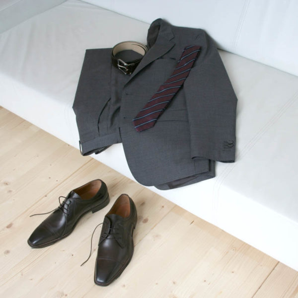 Photo men`s business shoes-Sophisticated design-dark brown mocha tone-2 shoes with a gray suit on a couch